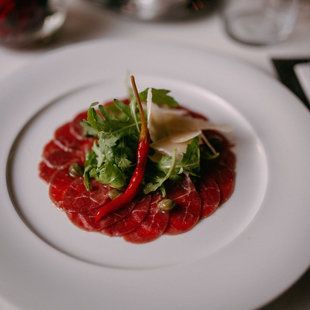 BEEF CARPACCIO WITH WHITE WINE AND CHILI SAUCE, PARMIGIANO SHAVINGS
